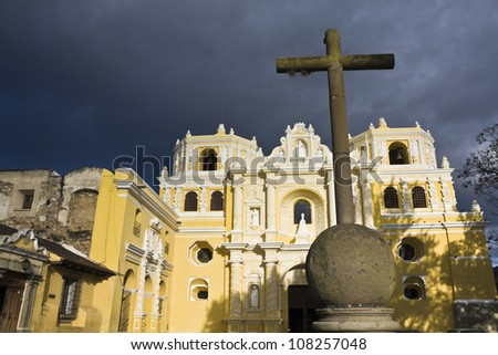 Cross in front of La Merced church in Antigua, Guatemala. - stock photo