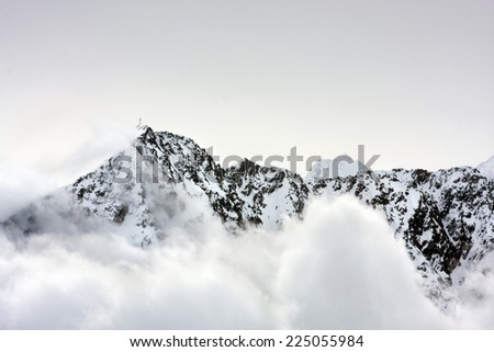 cross in the mountain summit in alps - stock photo