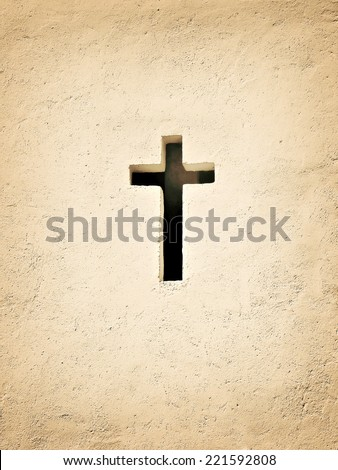 cross in the wall - stock photo