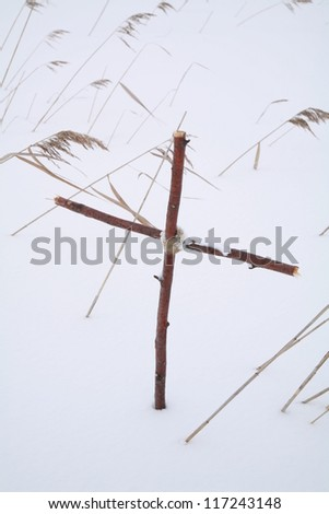 Cross in winterscene - stock photo