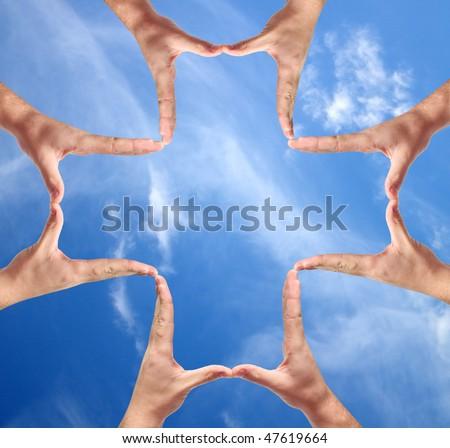 Cross made of human hand - stock photo