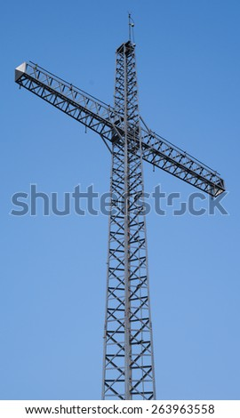 Cross made of metal. Similar crosses are located on the summit of the mountains in the Alps. - stock photo