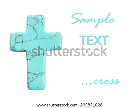 Cross made of semi precious stones isolated on white background - stock photo