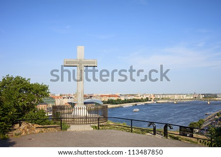 Cross monument on the Gellert Hill, Danube river and city of Budapest skyline in Hungary.