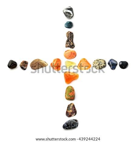 Cross of gems - Composition of semi-precious gemstones, isolated on white background, symbolizing Sacred Heart of Jesus Christ - stock photo
