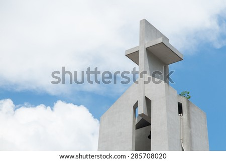 Cross of the Church with the blue sky - stock photo