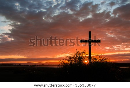 Cross on a hill as the morning sun comes up for the day