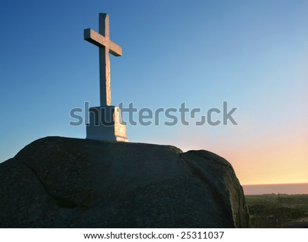 Cross on a sunset - stock photo