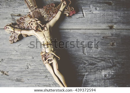 Cross on a wooden table background
