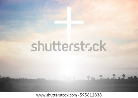 cross on blurry sunset background. Easter morning