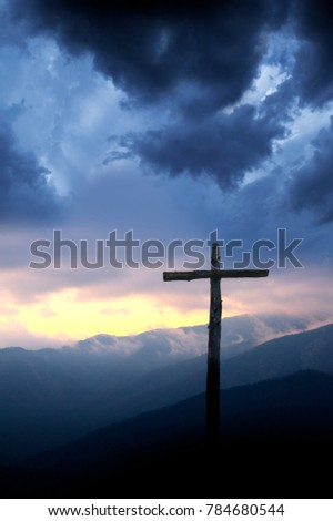 Cross on Hill in Storm