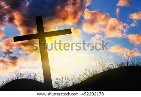 Cross on sunset, Concept conceptual black cross, Gospel concept. - stock photo