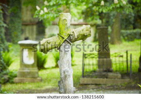 Cross on the grave - selective focus - stock photo