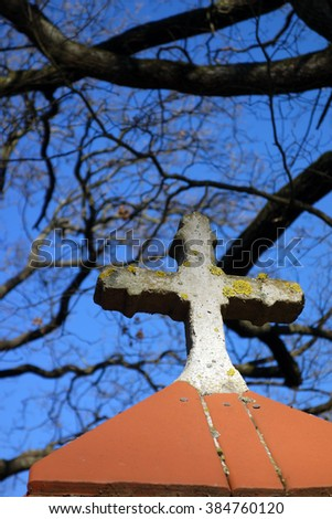 cross on the roof of a small chapel - stock photo