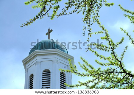 Cross on the top of old church. Taken in Georgetown, Washington DC, USA - stock photo