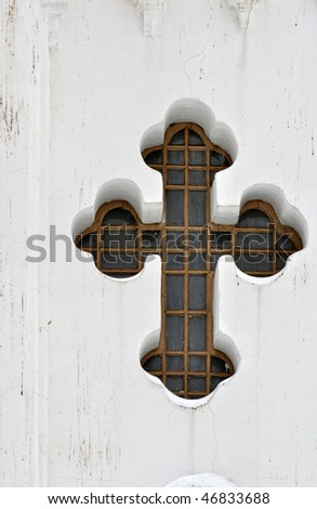 Cross on the wall of temple - stock photo