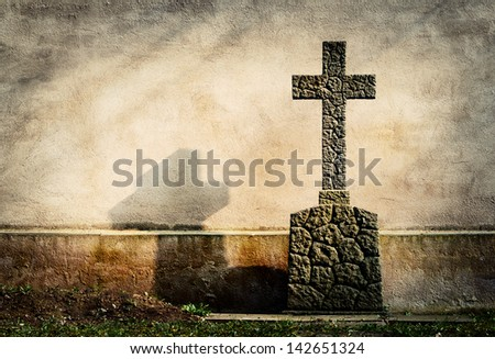cross on tombstone grunge wall background - stock photo
