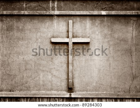 cross on wall background - stock photo