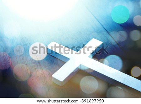 Cross on wood and bokeh background,christian background,blur bokeh ,Christian concept,riligion background,peace background,cross and Christian , jesus Christian background,god belief Christian  - stock photo