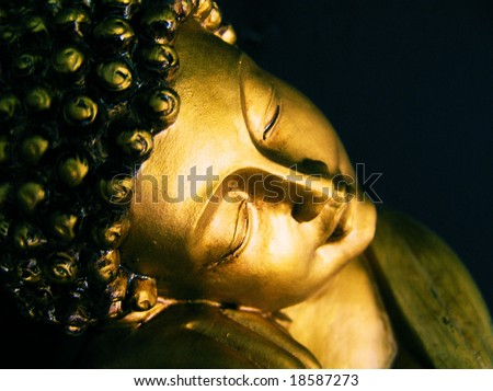 cross process photographic reproduction of a reclining buddha statue - stock photo