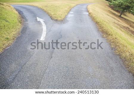 Cross roads horizon with grass. - stock photo
