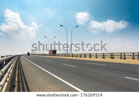 cross-sea bridge against a blue sky in shanghai  - stock photo