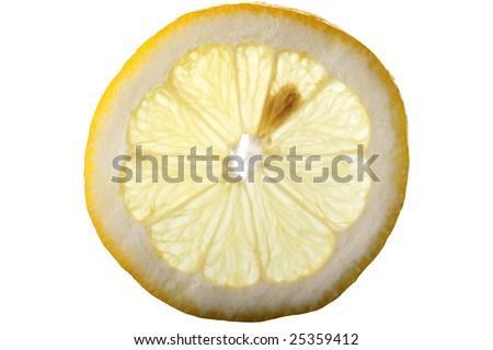 Cross section of a Lemon. Backlit slice of a fresh lemon fruit, against white - stock photo