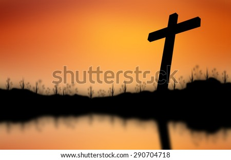 Cross silhouette reflected on water Sunset background - stock photo