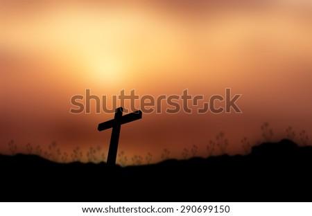 Cross silhouette sunset background. - stock photo