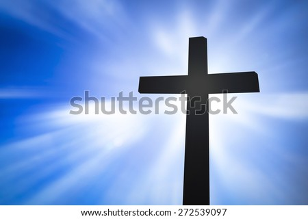 Cross silhouette with the blurred nature background.