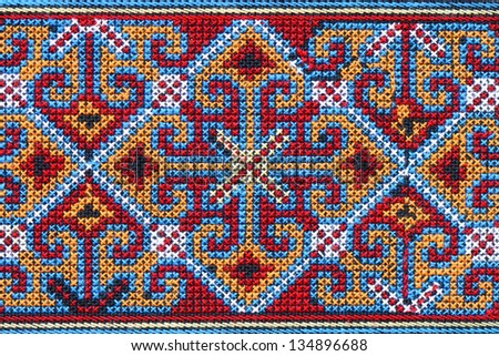Cross stitch embroidery on canvas. - stock photo