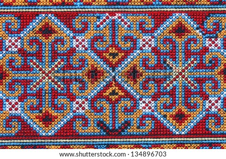 Cross stitch embroidery on canvas.Tribal handmade woven cotton fabrics form Chiengmai, Thailand. Pattern for design element.