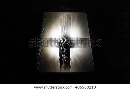 Cross with light and book in dark,Faith belief and hope concept - stock photo