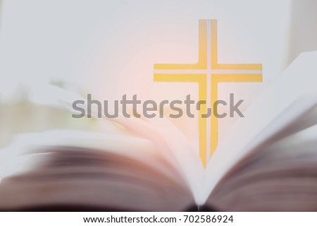 Cross with open holy bible