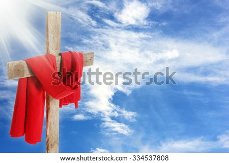 Cross with red cloth on sky background - stock photo
