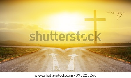 cross with road and sunlight background with shadow edge - stock photo