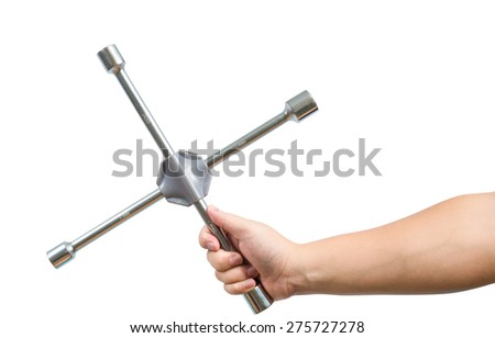 Cross wrench in male hand isolated on white, with clipping path. maintenance concept - stock photo