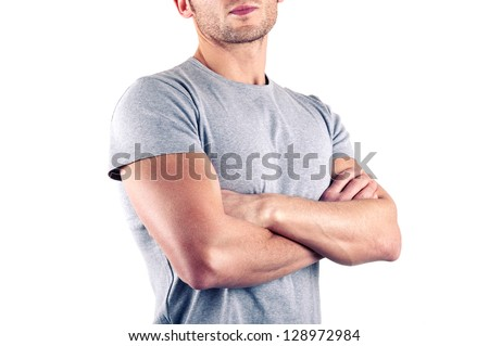 Crossed arms close up of muscular man on white background.