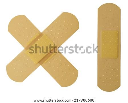 Crossed bandaid isolated over white - stock photo