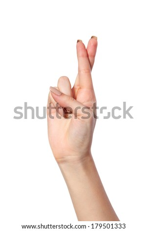 Crossed fingers symbolizing good luck isolated on a white background