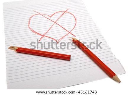 Crossed heart with a broken pencil on paper. White background - stock photo