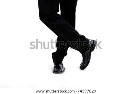 crossed legs of a business man with his pants, taking a break. white background