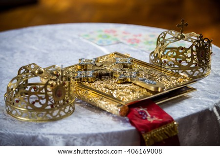 Crosses, books and crowns on a wooden table