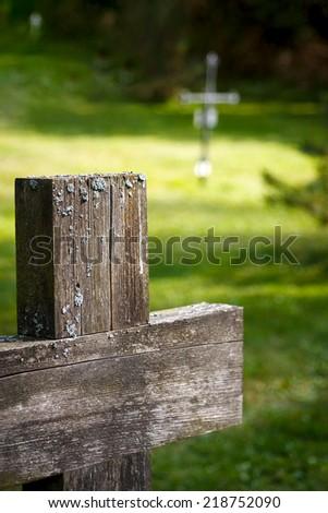 Crosses in diagonal at cemetery - stock photo