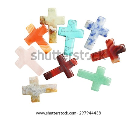 Crosses made of semi precious stones isolated on white background - stock photo