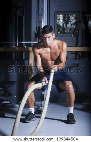 Crossfit battling ropes at gym workout exercise - stock photo