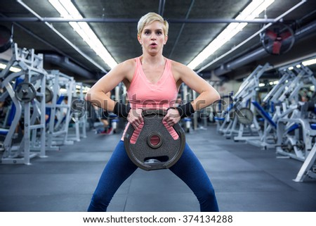 Crossfit exercise modern young style female training for weight loss and endurance in gym  - stock photo