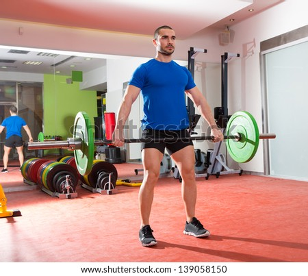 Crossfit fitness gym weight lifting bar by strong man workout - stock photo