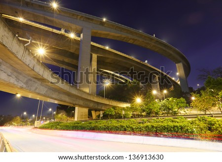 crossing highway overhead at night - stock photo