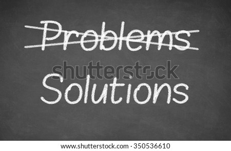 Crossing out problems and writing solutions on a blackboard. Chalkboard